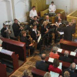 11 members of the three brass bands in Midden-Delfland play my compositions Festival in 't Woudt, and Green, Green Midden-Delfland, directed by Pasha Ashari, in the presence of our Dutch Queen Beatrix (November 2005)
